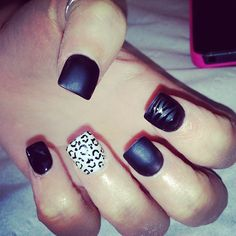 Matte black nails with simple accents