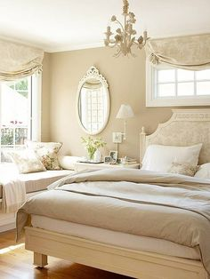 Classy Simple Bedroom. Looks so inviting. I have almost that same mirror which I love.