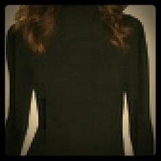Whitehouse black market L/S ribbed  Turtleneck Gorgeous Black long sleeve ribbed Turtleneck.  3 silver buttons on each cuff, 3 silver buttons on Turtleneck. Classy and chic perfect for any occasion weather it be a gala, tea time or lunch with the girls.   100% of sales go to a fellow Posher who was left destitute by her ex husband after he fled indictment by the FBI due to committing fraud. Ceasing child support and alimony payments she is in foreclosure and her car repossessed. She is…