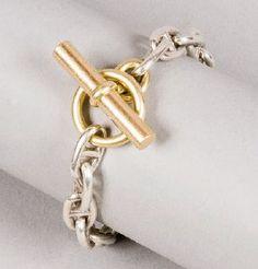 Hermès - Chaîne d'ancre- argent, fermeture baton et anneau en or jaune.