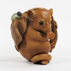 Netsuke, hand-carved & stained boxwood, buffalo horn and sheep's horn.
