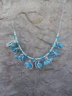 This necklace i have made with blue aquarium stones wire wrapped it with…
