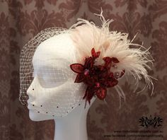 Hand dyed blush pink feather fascinator with red sequin flowers. Ivory birdcage veil with red Swarovski crystals. By Rockstars and Royalty