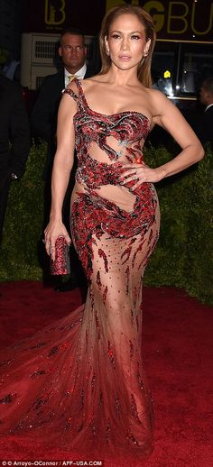 Daring to bare: Jennifer Lopez made sure to highlight her derriere in a racy red Versace g...