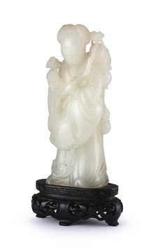 A white jade figure of Lan Caihe, Qing dynasty, 18th century