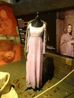 A frock and shawl worn by Anne Hathaway as Fantine, in the film adaption of the Broadway musical Les Miserables, based on the novel by Victor Hugo. Costume design by Paco Delgado.