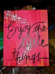 Truly enjoy the little things with this 8x10 hand painted canvas. Painted with a blend of pink, coral, and orange paint. With white designs and