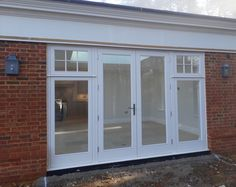 Painted hardwood French doors with fixed sidelights having fanlights above with bond-on georgian bars Timber Windows, Loft Room, Surrey, Joinery, Georgian, French Doors, Bond, Hardwood, Carving