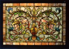 Antique American Stained Glass Windows Love the colors and the jaggedy flowers.