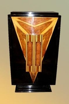 If Batman had a 1930s art deco cabinet in stately Wayne Manor, I'm pretty sure this was it.
