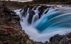 Download wallpapers mountain river, waterfall, Iceland, stones, evening, sunset