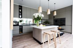 Fenix kitchen bench l Pear artwork l Wooden pendant lights l Wood bar stools l Open plan kitchen #theblock #stylecurator