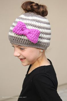 Use this ponytail hat crochet pattern to make a fun hat for your little girl. This messy bun hat is the perfect way to keep your little girl's head warm!