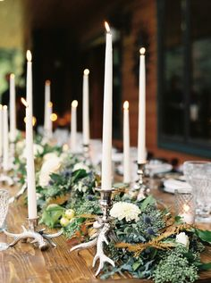 Rustic garland + candle topped table: http://www.stylemepretty.com/montana-weddings/columbia-falls/2016/03/03/rustic-intimate-northwest-montana-wedding/ | Photography: Jeremiah and Rachel - http://jeremiahandrachel.com/