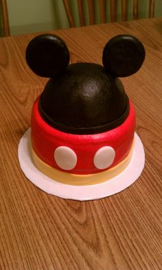 Red Velvet smash cake. Cap is cake, ears are krispie treats covered in fondant..