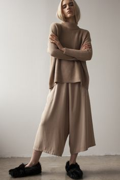 S A L E Elastic waist, dropped-crotch, cropped, culotte pant with unusual pant paneling. Poplin waistband is finished with raw edge. Rectangular side seam welt pockets. French seams. Italian Boiled Wo
