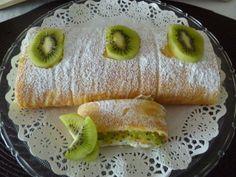 Brazo de gitano relleno de nata y kiwi | Cocinar en casa es facilisimo.com