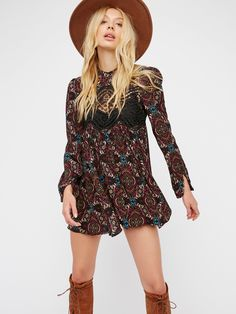 Sweet Thang Printed Tunic   Printed long sleeve tunic with a bohemian feel and cute front crochet accents. Skin baring open back design. Features an easy, swingy shape and a lightweight, semi-sheer fabrication.
