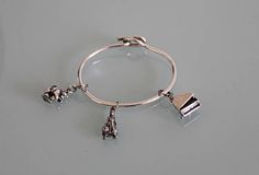 Vintage Sterling Silver Bangle Charm Bracelet. Big silver bracelet with 3 silver charms. Silver piano charm, Silver cat charm, and Silver working lady charm
