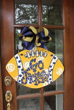 I LOVE how much everyone LOVES their teams! Just a few footballs shouting school spirit on doors this fall....