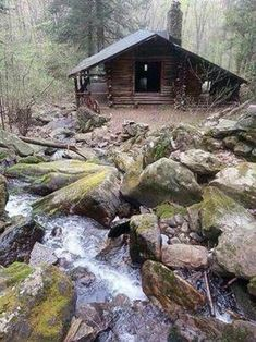 Log cabin by a stream. #logcabin