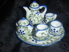 Miniature Tea Set handcrafted and hand painted in Northern Thailand.  Price $23.50.  All items at Arts of the World Gallery are Fair Trade.  We support indigenous artists from around the world.  Please visit us in Salt Lake City, Utah. http://www.artsoftheworldgallery.com/ For online purchases please visit our Etsy store.  https://www.etsy.com/shop/ArtsWorldGallery