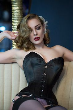 Looking for your perfect corset? Dreaming of flaunting your figure in the stunning hourglass curves of our Laurie? If you're looking for the ultimate indulgence you just HAVE to have, book yourself in for a corset fitting at one of our boutiques, and luxuriate in the feeling of your very own perfectly fitting corsetry. Sam Elson photographed by Tigz Rice in our Laurie Corset, Betty Lingerie and Grey Glamour Seamed Stockings