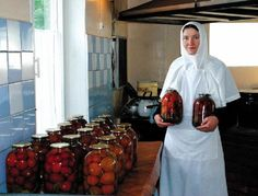 Russian Orthodox nun preserving fruit in the convent kitchen....