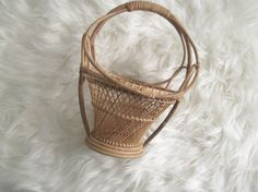 Boho Chic style vintagr wicker planter.  This basket style plant stand is adorable for your Jungalow or Bohemian style home.  Wicker basket style planter is a great retro Hippie addition to your Mid Century Modest Style home.  Condition:  Good vintage condition with no structural issues. No broken reeds.  Approximate Measurements:  Height: 10 1/2 inches Width: 8 inches (at the widest part of the handle)