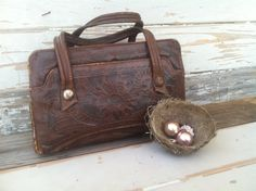 Check out this item in my Etsy shop https://www.etsy.com/listing/188846026/hipster-hand-tooled-leather-purse-on