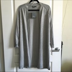 Long Gray Cardigan NWT! Beautiful gray cardigan from 89th & Madison. Fits like a Small/Medium. Sleeves can be folded or left unfolded depending on your preference (see 2nd photo - left side has been left unfolded and right has been folded once like in the first photo). Two slits on both sides.  CLOSET DEAL DOES NOT APPLY UNLESS BUNDLED Sweaters Cardigans