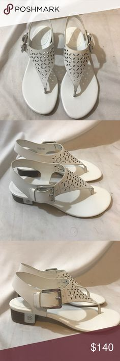 Brand new Michael Khors sandals 7 1/2 Brand new Michael Khors sandals with silver logo Box included Michael Kors Collection Shoes Sandals