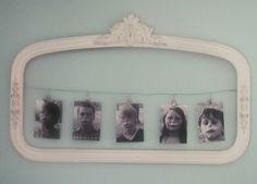 Photos strung up in a pretty frame