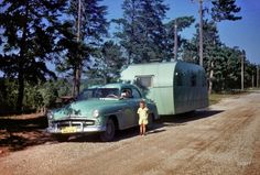 """Burt Lake, 1951."" Our young man with color-coordinated Plymouth and travel trailer, and Mama at the wheel."