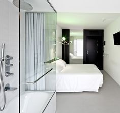 This is rather stark, but I like it -- lots of clean lines, and the contrast isn't so high that it induces headaches. Hotel Acta Mimic, Barcelona. #hotels #acta_mimic #barcelona #bedrooms #white #black