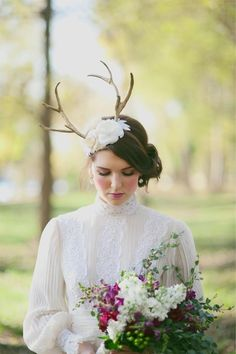 hmmmm I would have the groom wearing the antlers, this makes no sense 3 stars ***  Antler Mini Hat | 47 Gorgeous Wedding Headpiece Ideas