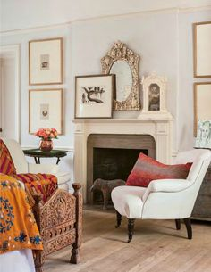 Modern global stye in a living room featuring neutral art & decor with colorful textiles - Bohemian Decor & Design Ideas