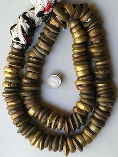 Africa | A strand of brass ring beads from the Yoruba people.