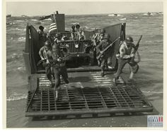 An LCM unloads infantry onto Lake Ponchatrain beach during demonstration in New Orleans in July 1944. Gift in memory of Andres N. Horcasitas, from The Digital Collections of the National WWII Museum. 2009.428.015.