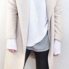 beige coat and white sweater