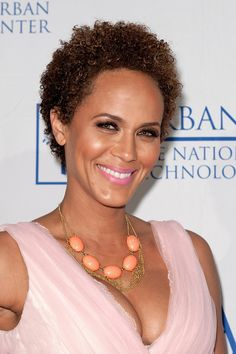 Nicole Ari Parker shows off her short halo of tight curls.
