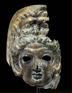 A GREEK BRONZE MASK OF HERAKLES LATE CLASSICAL PERIOD, CIRCA 4TH CENTURY B.C.