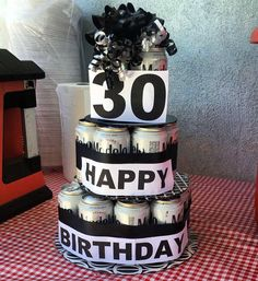 Beer cake done with 24 pack of Modelo, tied them with ribbon using a hot glue gun, and the big letters and number is probably printer paper I just printed it in huge letters and then taped then to ribbon or use hot glue gun for better attachment. #BeerCake #beer #mancake #modelo #blackandwhite