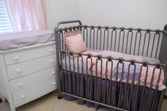 Purple crib skirt with Pink and lavender in the nursery
