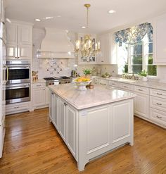 The island:We put in a larger, more functional, island that was designed with a beautiful natural stone countertop.