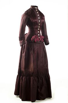 Plum silk taffeta two-piece dress, 1883. This stylish outfit has a second bodice, with plaid velvet lapels and cuffs, a feature that would extend the usefulness of this dress