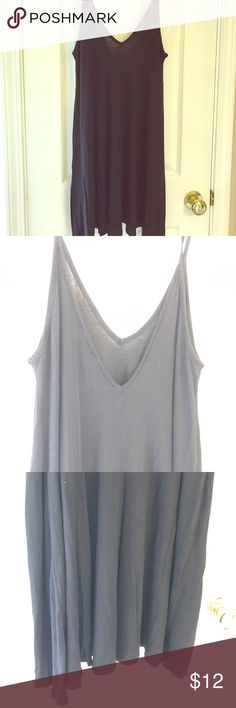 Black Tunic tank Excellent condition! Wore once. The perfect black tunic tank. Perfect with leggings, shorts or even as a cover up. Very flows and loose fitting. SO SOFT!!!96% rayon 4% spandex. Comes from a smoke free home. Tops Tunics
