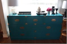 My sister @Katherine Harrison's campaign dresser. I found at the flea market and we painted it Behr Beach Towel, awesom teal color.