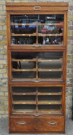 I absolutely love this. Great reuse of old storage. Perfect art cabinet, don't you think?  Elemental - reclaimed shop fitting