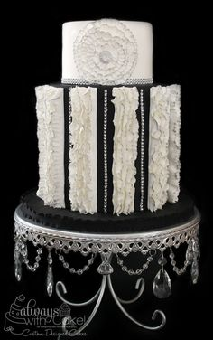 Black and White Splendor  wedding Cake ~ A little Glitz, ruffles and the tips are painted with silver luster.  ...